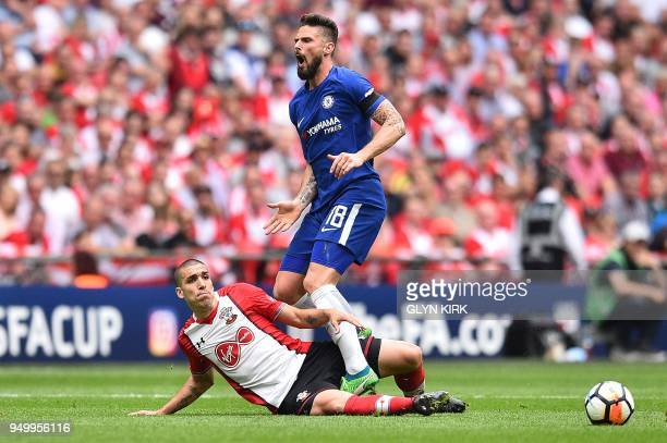 Southampton's Spanish midfielder Oriol Romeu fouls Chelsea's French striker Olivier Giroud during the English FA Cup semifinal football match between...