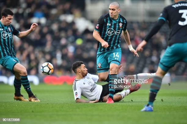 Southampton's Spanish midfielder Oriol Romeu tackles Fulham's English defender Ryan Fredericks during the English Premier League football match...