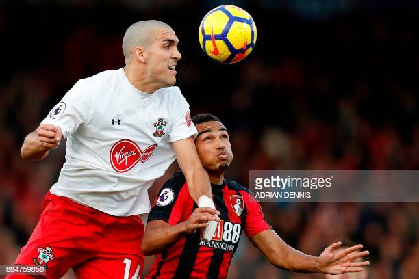 Southampton's Spanish midfielder Oriol Romeu vies with Bournemouth's English midfielder Junior Stanislas during the English Premier League football...