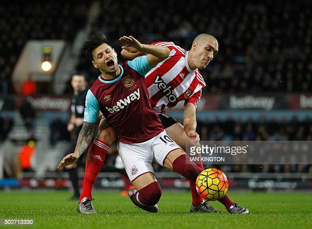 Southampton's Spanish midfielder Oriol Romeu vies with West Ham United's Argentinian striker Mauro Zarate during the English Premier League football...