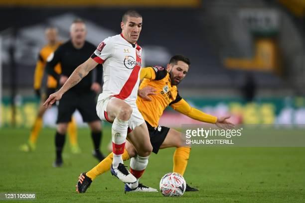Southampton's Spanish midfielder Oriol Romeu vies with Wolverhampton Wanderers' Portuguese midfielder Joao Moutinho during the English FA Cup fifth...