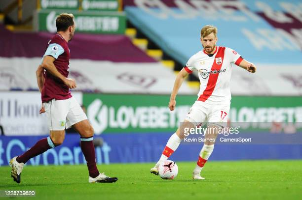Southampton's Stuart Armstrong under pressure from Burnley's Dale Stephens during the Premier League match between Burnley and Southampton at Turf...