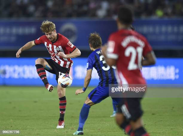 Southampton's Stuart Armstrong vies for the ball with Jiangsu Suning's Wang Song during the 2018 CSC International Football Club Super Cup football...