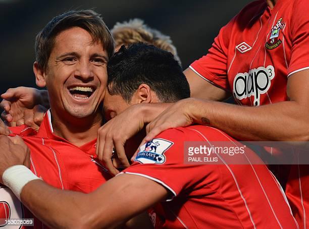 Southampton's Uruguayan midfielder Gaston Ramirez celebrates with teammates after scoring the opening goal during the English Premier League football...