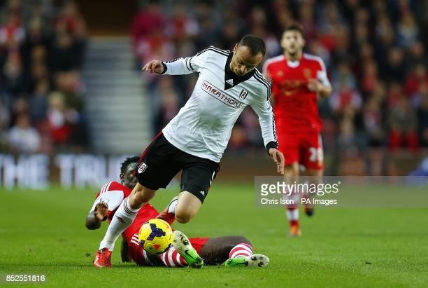 Southampton's Victor Wanyama and Fulham's Dimitar Berbatov battle for the ball