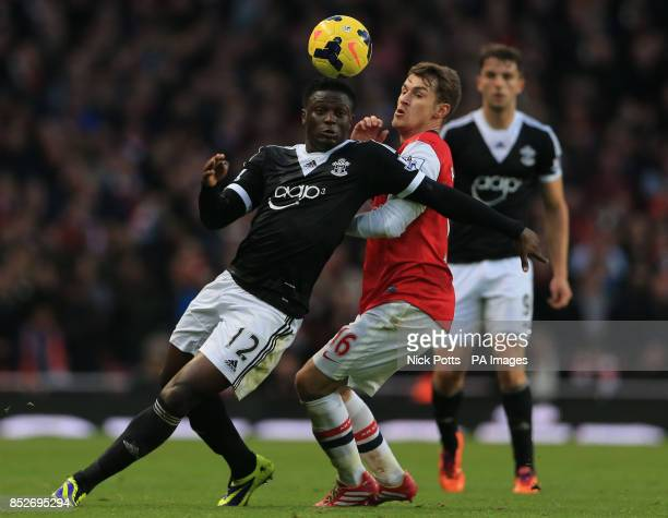 Southampton's Victor Wanyama tussles for the ball with Arsenal's Aaron Ramsey during the Barclays Premier League match at Emirates Stadium London
