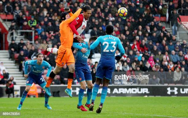 Southampton's Virgil Van Dijk jumping with Arsenal goalkeeper Petr Cech during the Premier League match between Southampton and Arsenal at St Mary's...