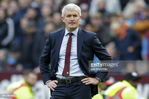 Southampton's Welsh manager Mark Hughes gestures on the touchline during the English Premier League football match between West Ham United and...