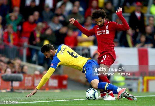 Southampton's Wesley Hoedt and Liverpool's Mohamed Salah battle for the ball during the Premier League match at Anfield Liverpool
