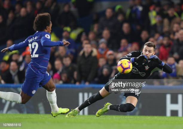 Southamton goalkeeper Angus Gunn saves from Willian of Chelsea during the Premier League match between Chelsea FC and Southampton FC at Stamford...