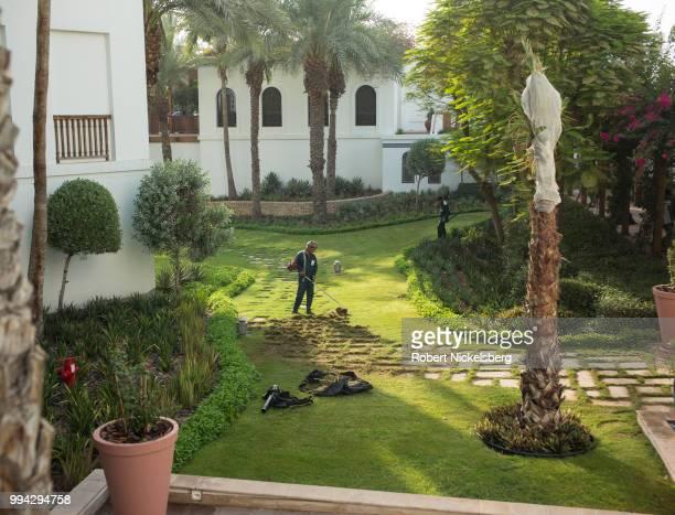 South-Asian employees landscape the grounds June 24, 2018 at the Park Hyatt Hotel in Dubai, United Arab Emirates, UAE.