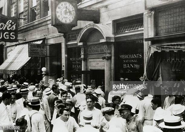 Crowds mill around the merchants National Bank after it was raided by a gang of five holdup men led by John Dillinger America's arch desperado The...