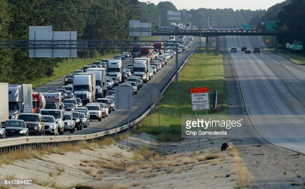 Southbound lanes of I95 near the GeorgiaSouth Carolina border are empty as northbound lanes are packed as pepole evacuate ahead of the arrival of...