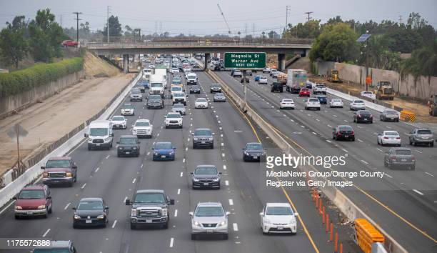 Southbound traffic on the 405 freeway, at left, approaches the new Slater Avenue bridge in Fountain Valley on Wednesday, August 28, 2019. The bridge...
