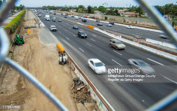 Southbound traffic on the 405 freeway, passes under the new Slater Avenue bridge in Fountain Valley on Wednesday, August 28, 2019. The bridge is...