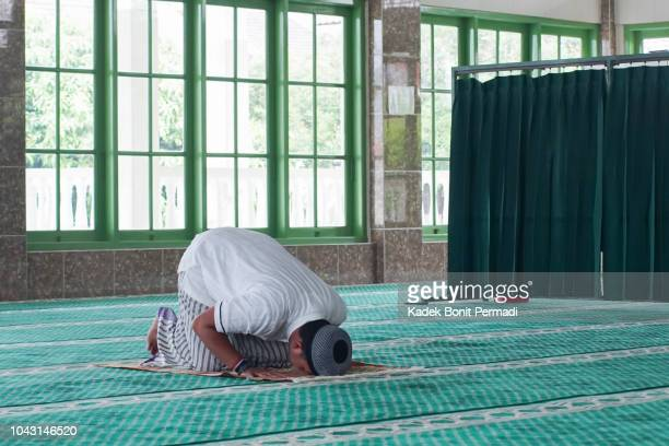 southeast asia muslim man doing prayer - allah stock pictures, royalty-free photos & images