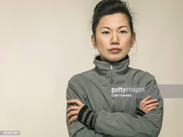 southeast asian female in sports jacket - gray coat stock pictures, royalty-free photos & images