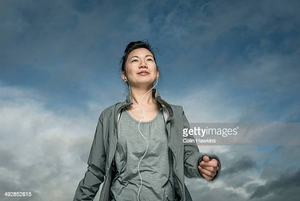 southeast asian woman exercising outside - colin hawkins stock pictures, royalty-free photos & images