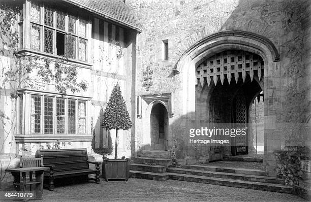 Southeast corner of the courtyard at Hever Castle Kent c1900 The double portcullis of the entrance arch of the gatehouse and the twostorey oriel...