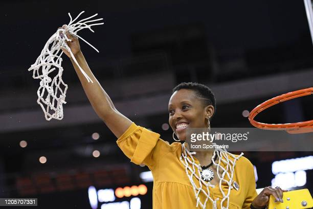Southeast Missouri Redhawks head coach Rekha Patterson cuts down the net at the conclusion of the Womens Ohio Valley Conference Tournament...