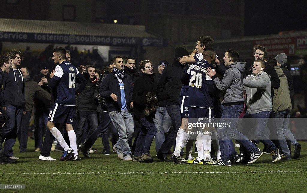Southend supporters invade the pitch after the final whistle during the Johnstone's Paint Trophy Southern Section Final match between Southend United and Leyton Orient at the Roots Hall Stadium on February 20, 2013 in Southend, England.