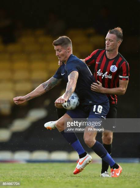 Southend United's Barry Corr battles for possession of the ball with Queens Park Rangers' Clint Hill during the preseason friendly at Roots Hall...
