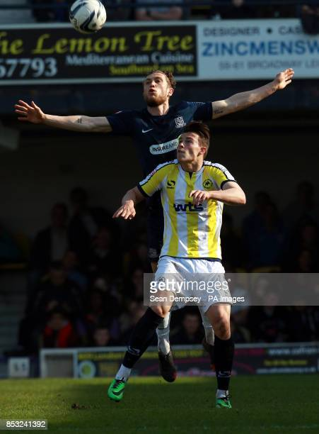 Southend's Ben Coker jumps for the ball with Torquay's Billy Bodin during the Sky Bet League Two match at Roots Hall Southend