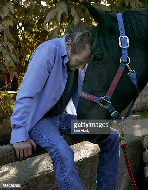 JD Souther spends a quiet moment with a horse at the Los Angeles Equestrian Center Veteran Southern California singer–songwriter John David Souther a...