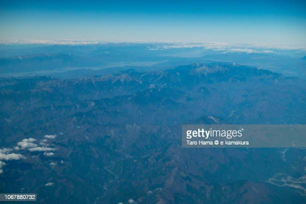 Southern Alps (Akaishi Mountains) in Japan daytime aerial view from airplane