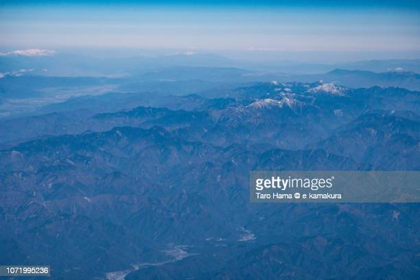 Southern Alps (Akaishi Mountains) in Shizuoka prefecture in Japan daytime aerial view from airplane