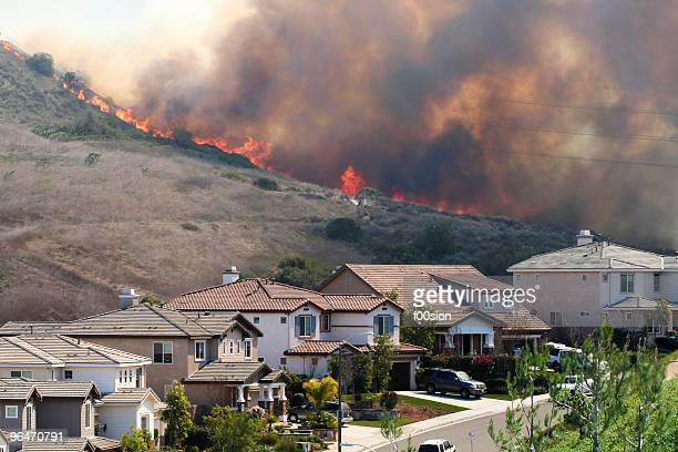 southern california brush fire near houses - california wildfire stock pictures, royalty-free photos & images