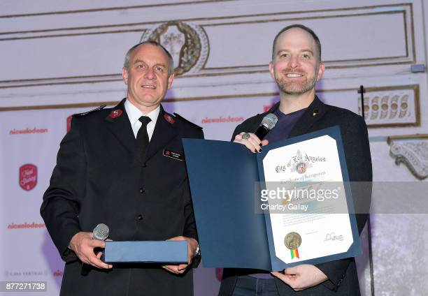 Southern California Divisional Commander Lieutenant Colonel Kyle Smith presents the Certificate of Recognition to Nickelodeon Senior Manager of...