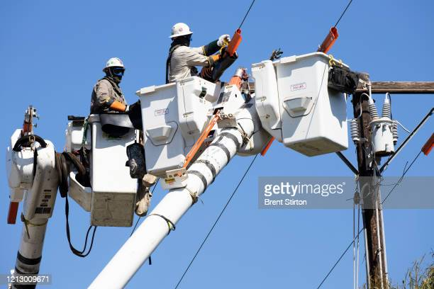 Southern California Edison crew installs a new overhead switch for circuit reliability on May 13, 2020 in Ventura, California. During the coronavirus...