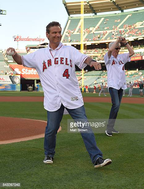 Southern California newscasters Fred Roggin and Fritz Coleman throw ceremonial first pitches before the game between the Oakland Athletics and the...