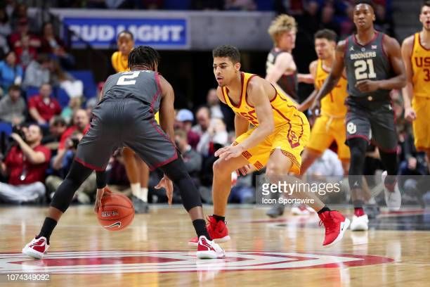 Southern California Trojans Guard Derryck Thornton guarding Oklahoma Sooners Guard Aaron Calixte during a college basketball game between the...