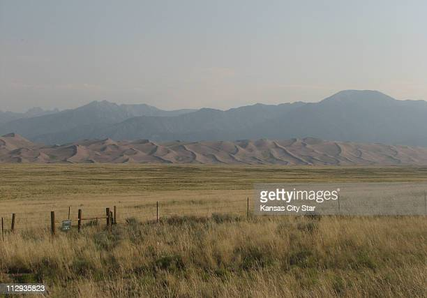 Southern Colorado grasslands the Great Sand Dunes and the Sangre de Cristo Mountains are visible from Colorado 150