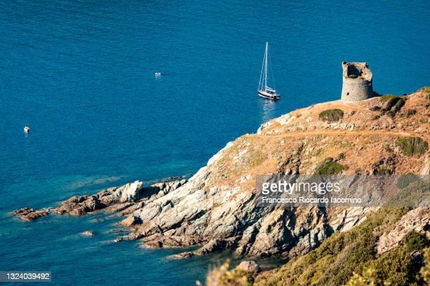 southern corsica island, blue sea bay with boats and coastline with ancient tower. france - francesco riccardo iacomino france foto e immagini stock