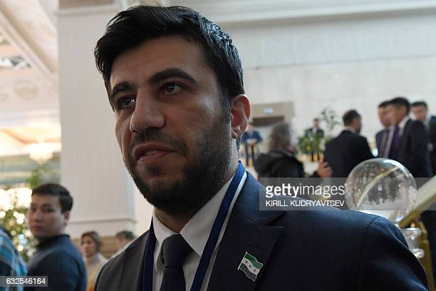 Southern Front spokesman Issam alRayyes whose faction is represented in the rebel delegation speaks to the media during the second day of Syria peace...