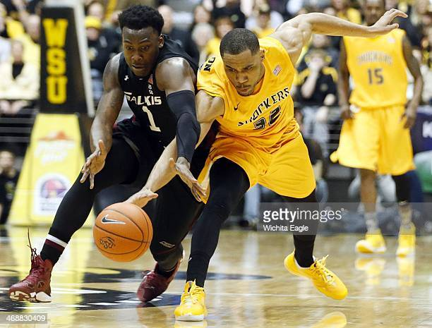 Southern Illinois' Jalen Pendleton and Wichita State's Tekele Cotton scramble for the ball in the final seconds of the first half at Koch Arena in...