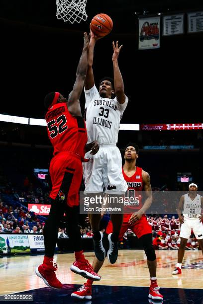 Southern Illinois Salukis center Kavion Pippen right goes up for a shot while under pressure by Illinois State Redbirds forward Milik Yarbrough...