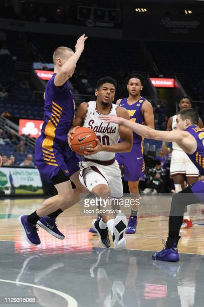 Southern Illinois Salukis guard Aaron Cook drives to the basket during a Missouri Valley Conference Basketball Tournament game between the UNI...