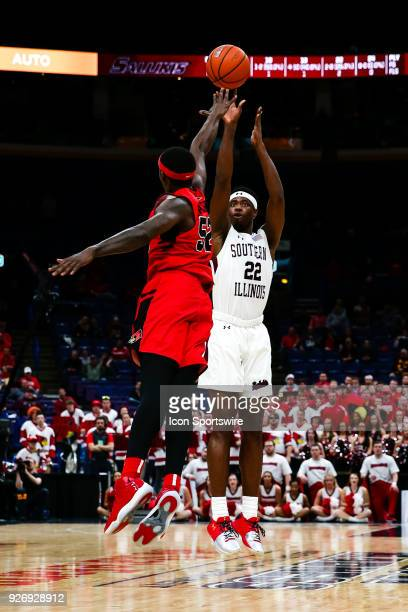 Southern Illinois Salukis guard Armon Fletcher right puts up a shot over Illinois State Redbirds forward Milik Yarbrough during the second half of a...
