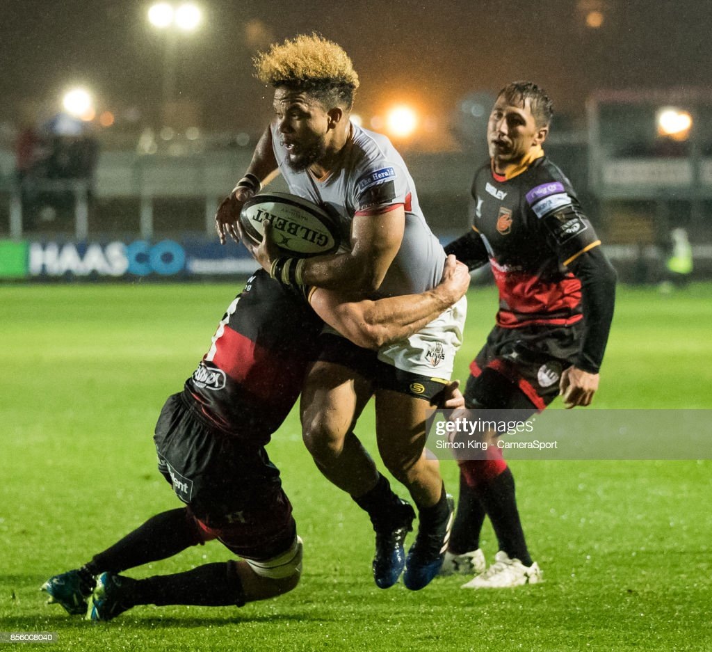 Southern Kings' Berton Klaasen under pressure from Dragons' Brok Harris during the Guinness Pro14 Round 5 match between Dragons and Southern Kings at Rodney Parade on September 30, 2017 in Newport, Wales.