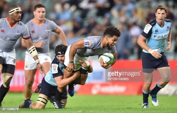 Southern Kings player Burton Klaasen is tacked by Micheal Wells of the Waratahs during the Super15 rugby match between Waratahs and South Africa's...