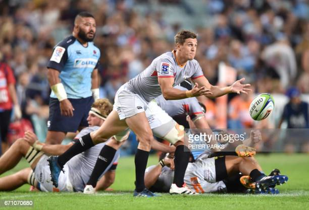 Southern Kings player Louis Schreuder clears the ball against the Waratahs during the Super15 rugby match between Waratahs and South Africa's...