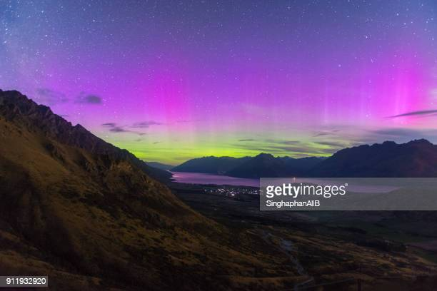 southern light in new zealand with the view of river, mountain and city lights, new zealand - aurora australis stock pictures, royalty-free photos & images