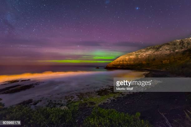 southern lights, aurora australis over the sea, sand dunes, second beach, dunedin, otago, southland, new zealand - dunedin new zealand stock pictures, royalty-free photos & images