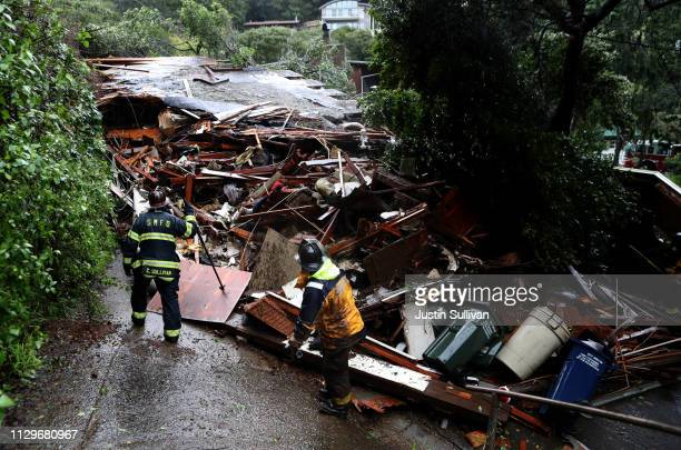Southern Marin firefighters search a home that was swept down a hill by a mudslide during a rain storm on February 14 2019 in Sausalito California 50...