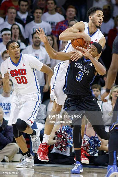 Southern Methodist Mustangs center Cannen Cunningham comes down with the ball over Tulsa Golden Hurricane guard Shaquille Harrison during the NCAA...