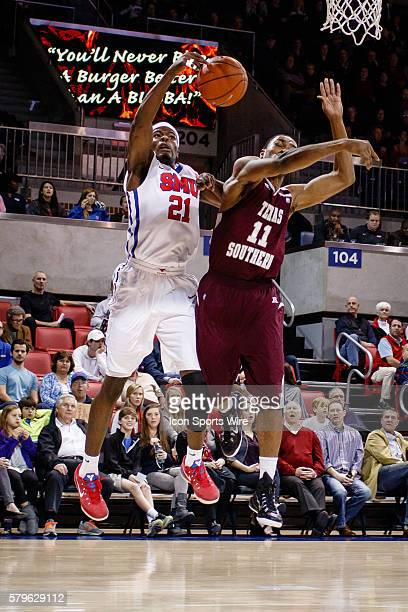 Southern Methodist Mustangs guard Ben Emelogu has the ball knocked away by Texas Southern Tigers forward Malcolm Riley during the NCAA Basketball...